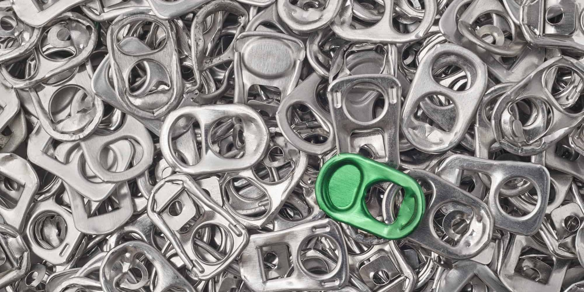 Recycling aluminum background with pull-tab pieces. Metallic waste. Horizontal